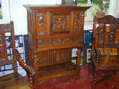 Renaissance-style cabinet and armchairs
